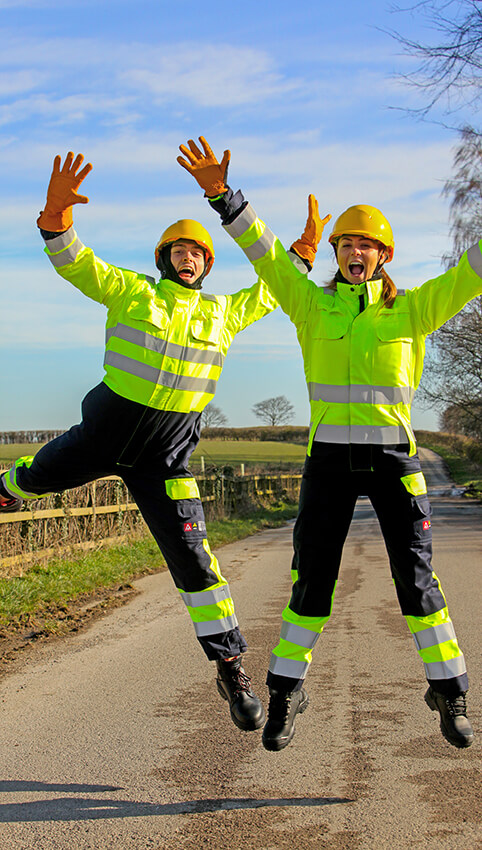 Hi visability arc flash PPE location shot of a girl and guy wearing, shot in Harley Rotherham
