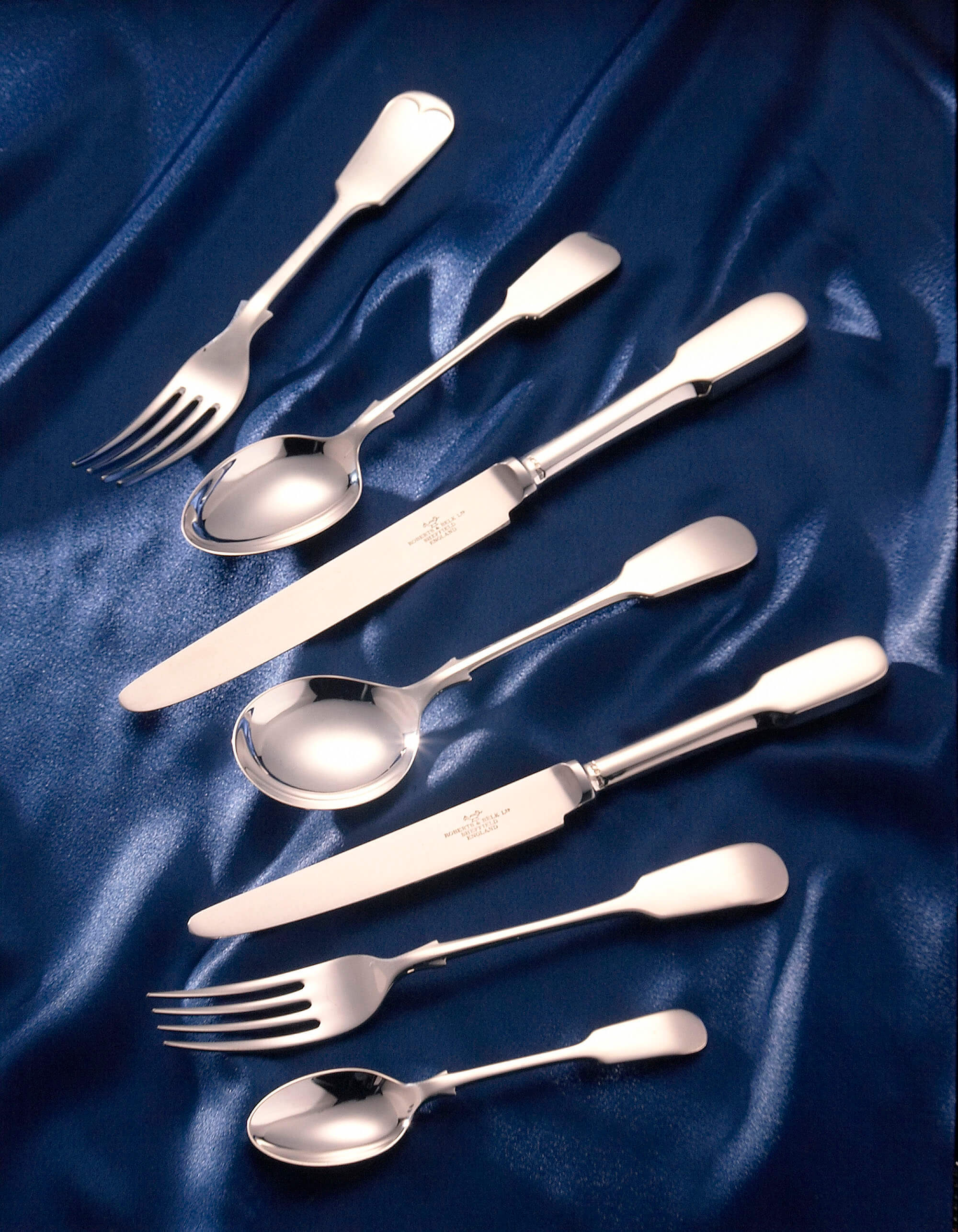 shot of a selection of silver cutlery shot in my Sheffield studio on blue satin